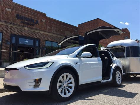 tesla outside tesla pops up a mobile gallery outside of the shinola