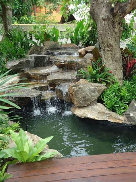 backyard waterfalls  wood deck