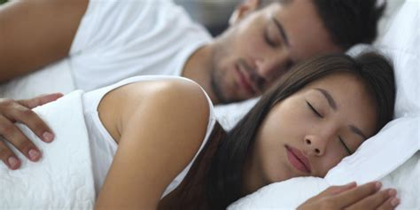 men and women in bed women spend a longer time in bed but get less sleep than men study huffpost