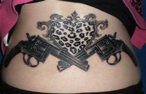crossed revolver tattoos 30 cool gun tattoos desiznworld