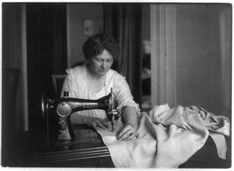 sew in for an older woman file woman sewing with a singer sewing machine png