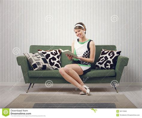 couch sitting girl sitting on the couch stock photography image 30173562