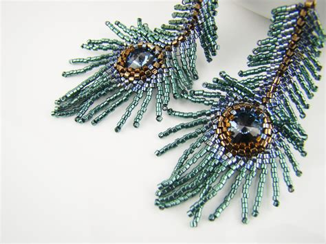 beaded feathers peacock feather earrings teal seed bead earrings denim