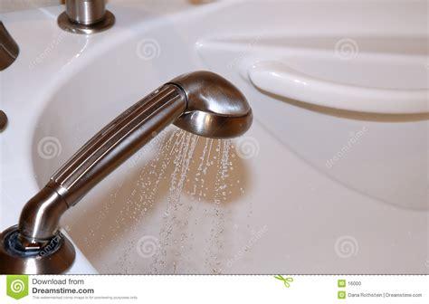 Spraying A Bathtub by Tub Spray Stock Photo Image 16000