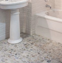 rock and pebble mosaic floor tile with subway tile on the