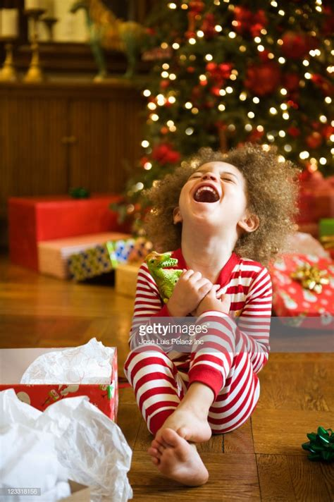 Excited Mixed Race Boy Opening Christmas Gift Stock Photo ... Happy Kids Opening Christmas Presents