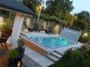 hydropool 19fx swim spa in multi tiered decking pool