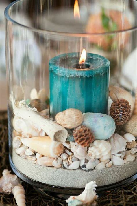 wedding centerpieces with candles and sand blue candle shell sand in glass cylinder centerpiece coastal weddings