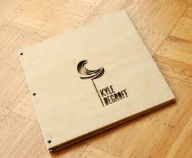 Handmade Graphic Design - custom bamboo portfolio book with logo cut out