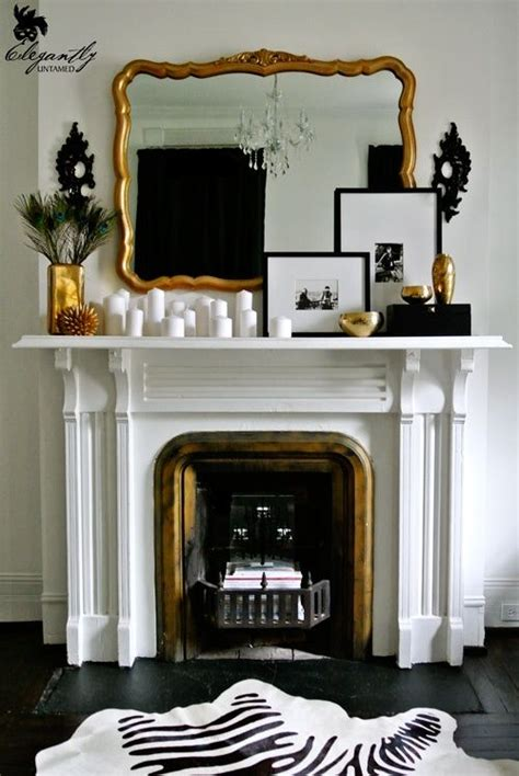 black and white fireplace gold mirror fireplace mantel white candles framed