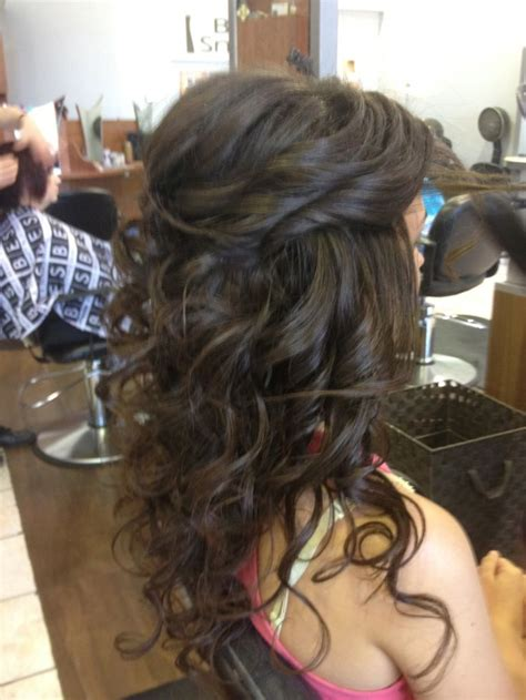 side view of pulled back hair in a bun long curls with a little pulled back hair style ideas