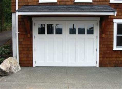 made custom vintage garage doors and real carriage