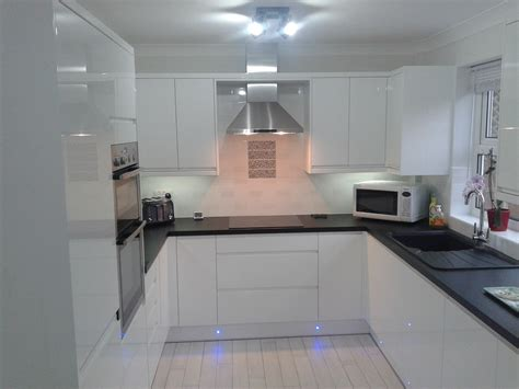 white gloss kitchen ideas wren kitchens handleless white gloss what do you think to this pristine kitchen white or
