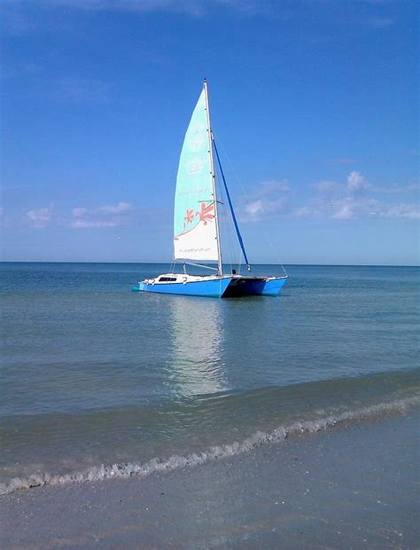 key west boat marco island catamaran in marco island florida photograph by laura miller