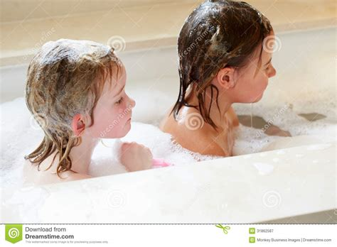 two girls in a bathtub girls sharing bubble bath stock image image of indoors