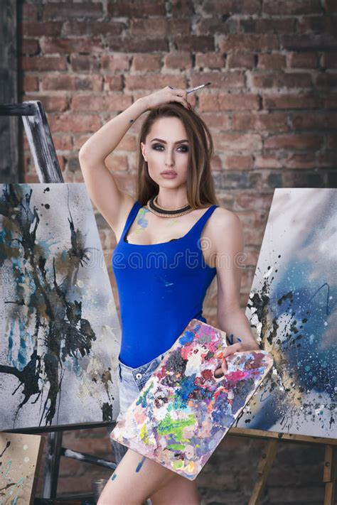 young female artist painting abstract picture  studio