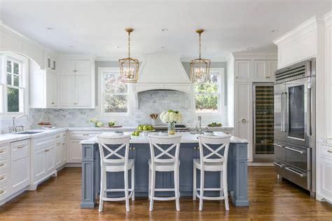 grey island and white cabinets white kitchen with stacked cabinets and grey island home