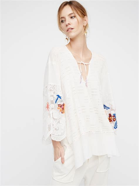 Flower Tunic embroidered flower tunic at free clothing boutique