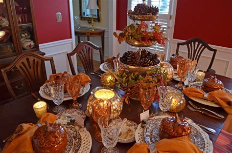Thanksgiving table decorations on dining room with golden thanksgiving