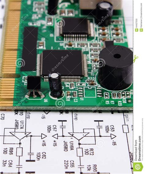 pcb layout contractor jobs printed circuit board lying on diagram of electronics