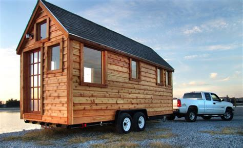 trailer houses couple built a house for themselves on top of a movable