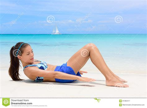 fitness woman training abs heel touches stock photo