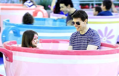 Tom And Throw A Tea For Suri by Tom Cruise Suri Take A Ride On The Tea Cups At Disneyland