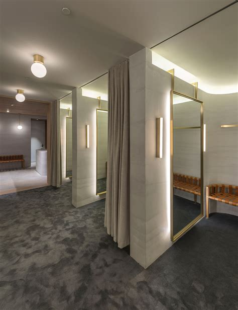 Fitting Room Partitions by Striated Concrete Partitions Create Fitting Rooms At