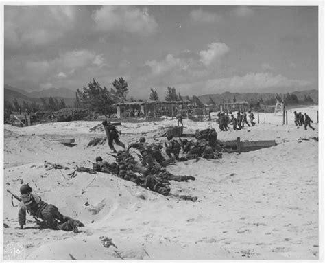 troops crawling forward during beachhead landing maneuvers