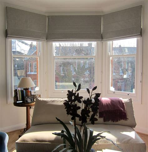 bedroom bay window curtains geometric patterned roman blinds in a bay window could