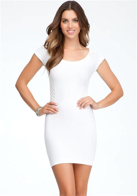 white bodycon dress bebe raglan sleeve bodycon dress in white lyst