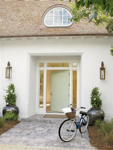 white beach home  light green front door cottage