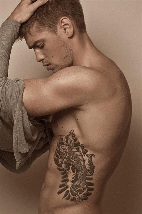 tattoo pain side ribs cool fish tattoo on rib for men tattoos for men