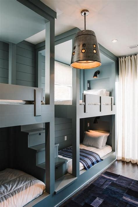 side by side bunk beds a gray built in bunk bed staircase leads to side by side