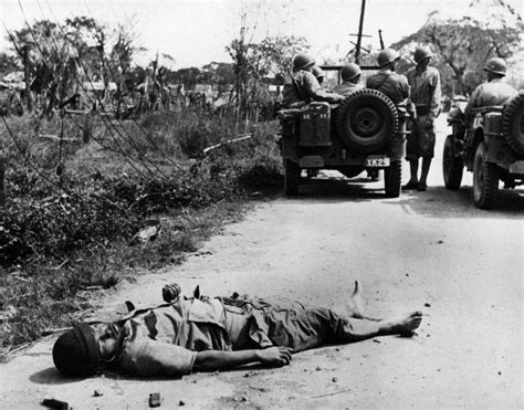 japanese jeep ww2 dead japanese soldier on road to manila 1945