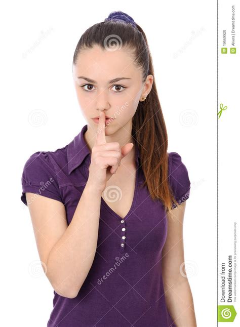 young woman holding finger  lips stock photo image