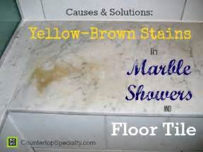 Rust Colored Bathroom - yellow brown stains in marble showers amp floor tile