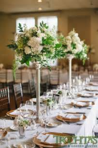 tall elegant table centerpieces that have white flowers but have black vases wedding flowers