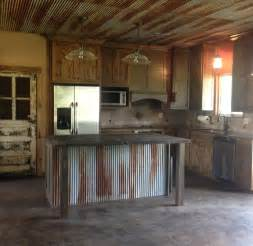 rustic kitchen with old door for pantry door custom made old dresser into rustic kitchen island after furniture