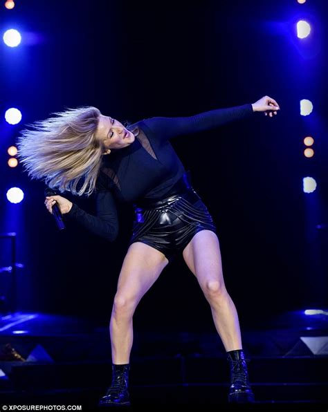 swing my hair back and forth ellie goulding shows off fabulous figure in low cut bralet