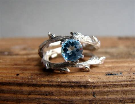 twig ring on pinterest branch ring twig engagement blue topaz engagement ringdouble twisted branch elvish