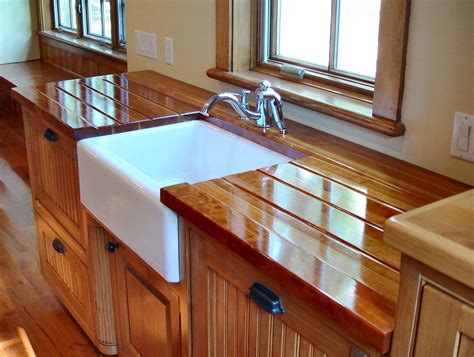 Kitchen Cabinet Finishing by Sink Cutouts In Custom Wood Countertops