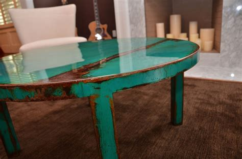 crafted custom metal coffee table with beautiful turquoise and jade green paint