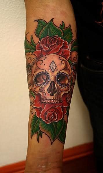 day of the dead rose tattoo flower and day of the dead skull on arm