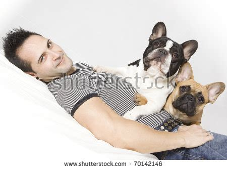 french men in bed handsome man playing his dog bed stock photo 584545249