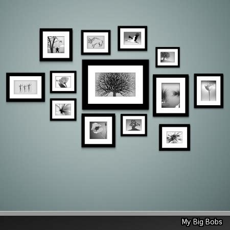 best way to hang pictures on the wall what s the best way to arrange pictures on a wall all