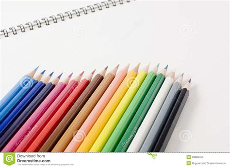 sketchbook and pencils sketchbook and colored pencils stock images image 23885764
