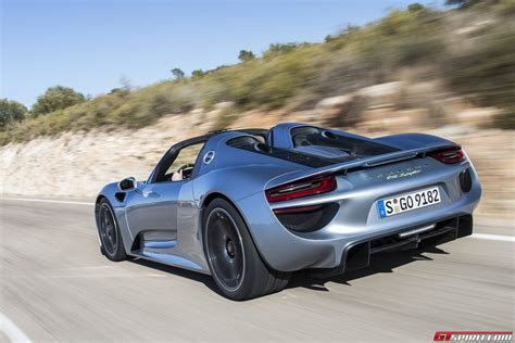 road porsche 918 spyder gtspirit 2014 porsche 918 spyder liquid chrome blue 0021