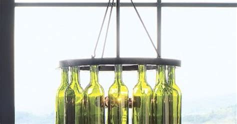 pottery barn wine bottle chandelier wine bottle chandelier i would like to make this but using an bicycle crafty diy