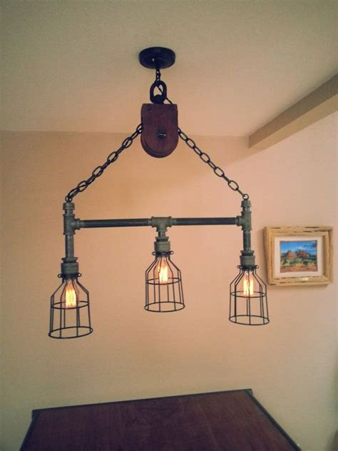 Hanging Light Fixtures Diy Best Ideas About Industrial Pipe Lighting Diy Lighting Pulley And Pulley Decor On
